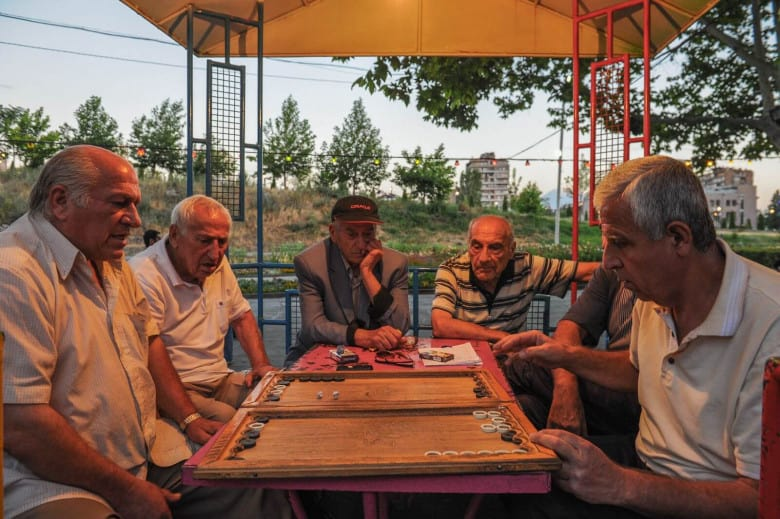 Armenian men playing nardi(backgammon)