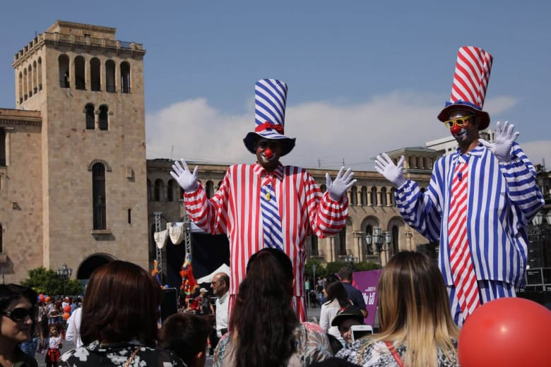 Stilt-walkers in Republic Square